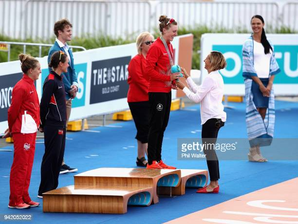 Former triathlete Emma Snowsill congratulates bronze medalist Joanna Brown of Canada during the medal ceremony for the Women's Triathlon on day one...