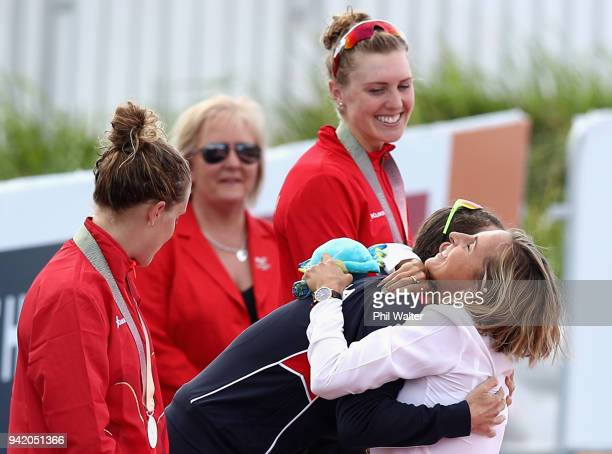 Former triathlete Emma Snowsill congratulates gold medalist Flora Duffy of Bermuda during the medal ceremony for the Women's Triathlon on day one of...