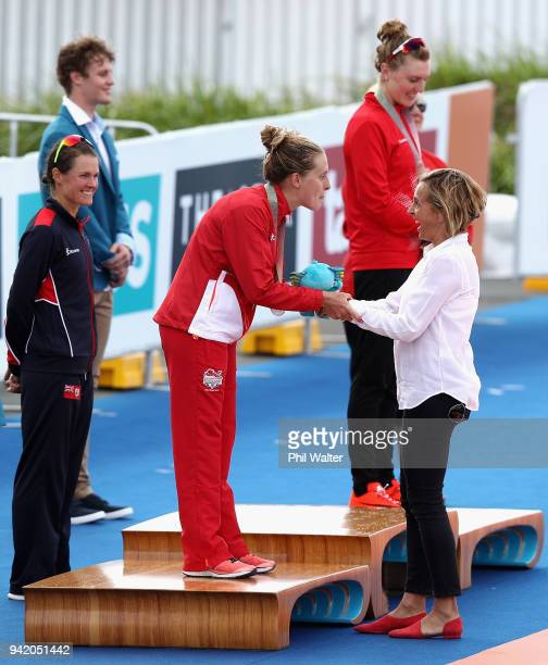 Former triathlete Emma Snowsill congratulates silver medalist Jessica Learmonth of England during the medal ceremony for the Women's Triathlon on day...