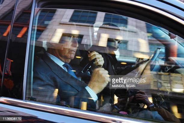 Former Trump campaign advisor Roger Stone is seen in a vehicle after departing from US District Court in Washington DC on February 21 2019 Stone was...
