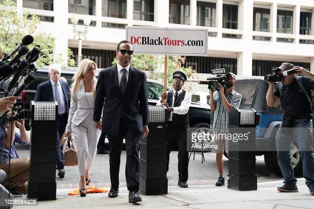 Former Trump Campaign aide George Papadopoulos arrives with his wife Simona Mangiante at the US District Court for his sentencing hearing September 7...