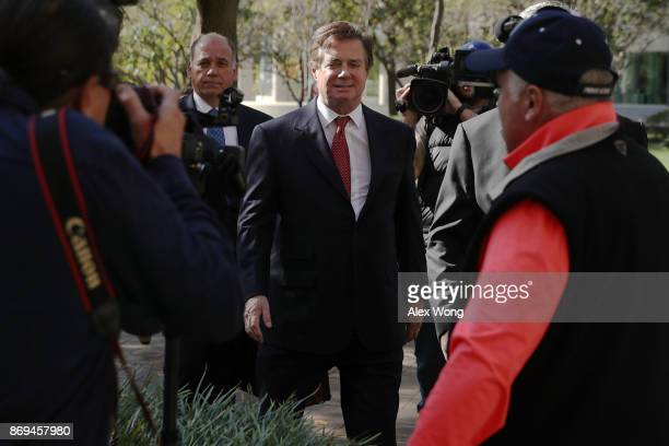 Former Trump campaign chairman Paul Manafort arrives at a federal courthouse November 2 2017 in Washington DC Manafort and his associate Rick Gates...