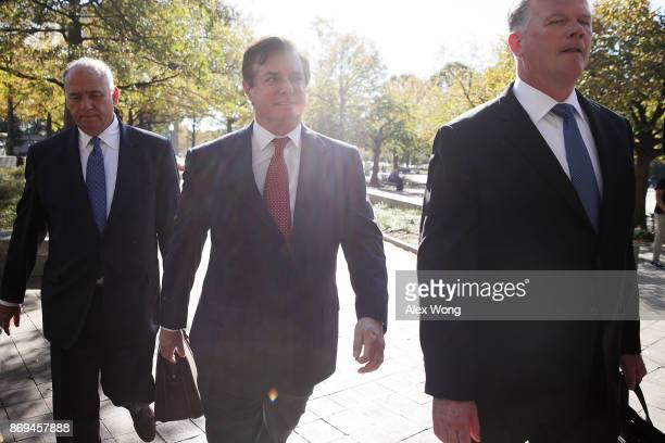 Former Trump campaign chairman Paul Manafort arrives at a federal courthouse with his attorney Kevin Downing November 2 2017 in Washington DC...