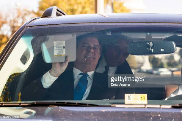 Former Trump campaign chairman Paul Manafort gets into his car after leaving federal court October 30 2017 in Washington DC Paul Manafort and Rick...