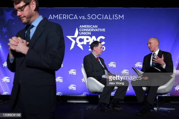 Former Trump Campaign foreign policy adviser Carter Page participates in a discussion with Rowan Scarborough of the Washington Times as a sign...