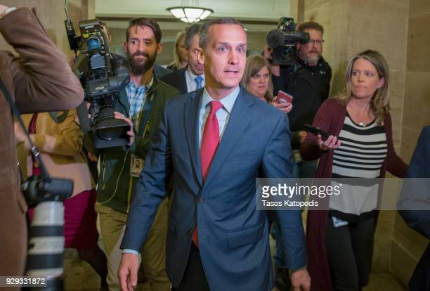 Former Trump campaign manager Corey Lewandowski is surrounded by members of the media as he leaves the House Permanent Select Committee on...