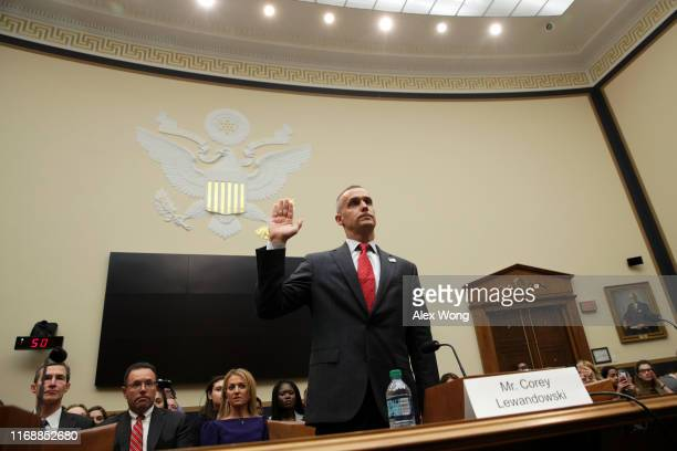Former Trump campaign manager Corey Lewandowski is sworn in before testifying in a hearing before the House Judiciary Committee in the Rayburn House...