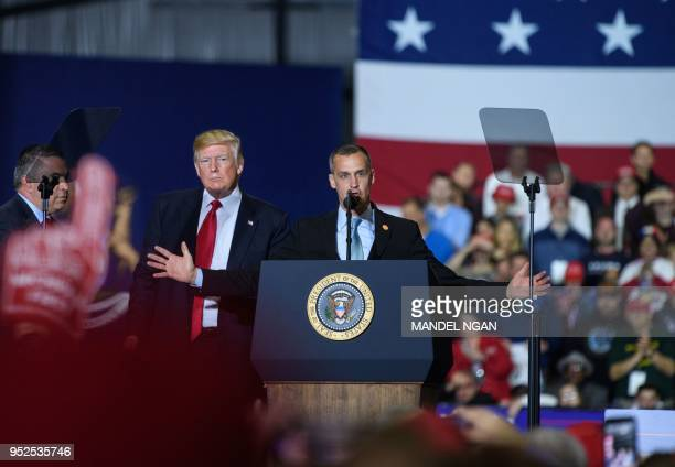 Former Trump Campaign manager Corey Lewandowski speaks as US President Donald Trump looks on during a rally at Total Sports Park in Washington...