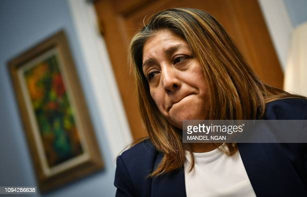 Former Trump National Golf Club employee Victorina Morales speaks during an interview with AFP in the office of US Representative Bonnie Watson...