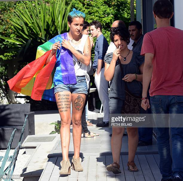 Former Tunisian Femen activist Amina Sboui and members of Tunisian 'Shams' association for the decriminalisation of homosexuality arrive for a press...