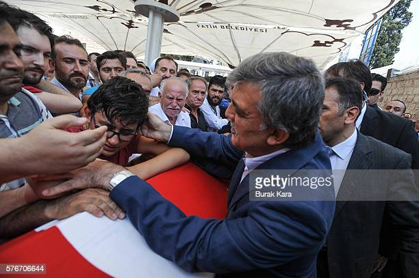Former Turkish President Abdullah Gul gives his condolences to the relatives the victims of the thwarted coup in Istanbul at Fatih mosque on July 17...