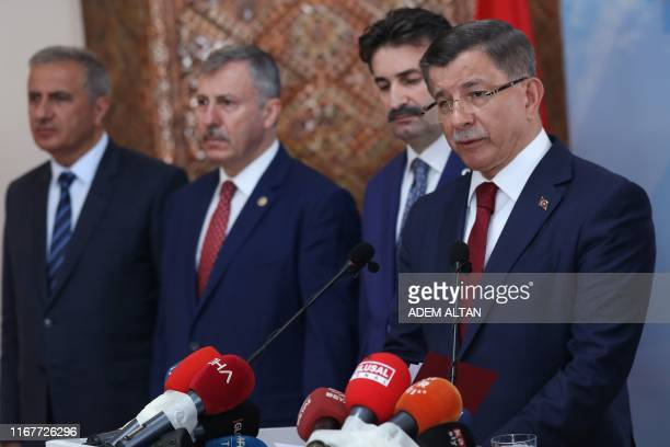 """Former Turkish Prime Minister Ahmet Davutoglu holds a press conference at his home in Ankara on September 13 to announce that he would launch a """"new..."""