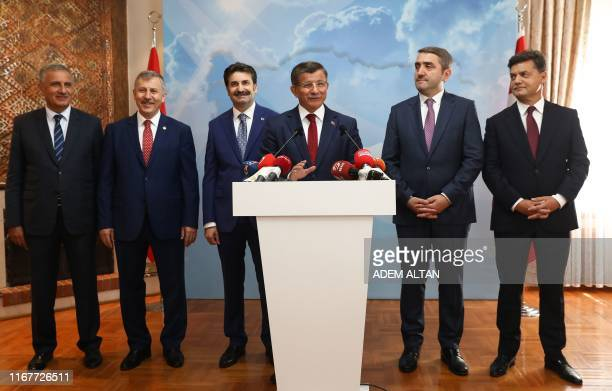 Former Turkish Prime Minister Ahmet Davutoglu holds a press conference at his office in Ankara on September 13 to announce that he would launch a...