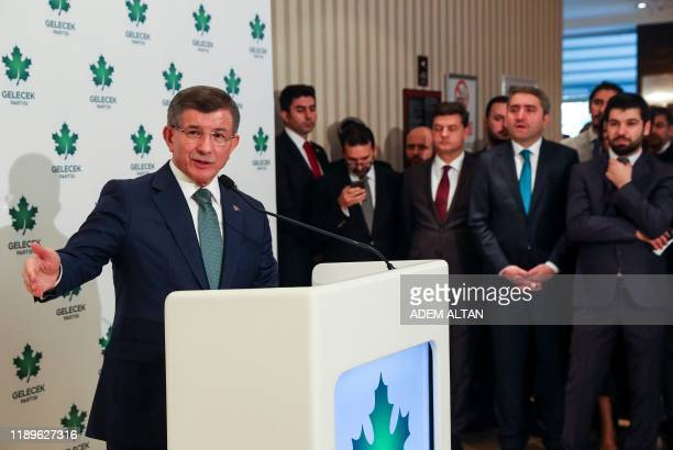 """Former Turkish prime minister and """"Future Party"""" chairman Ahmet Davutoglu gives a press conference after his party's meeting in Ankara on December..."""