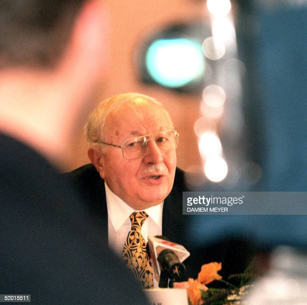 Former Turkish Prime Minister Necmettin Erbakan talks to the press at Strasbourg 27 June announcing that he engaged a lawyer to plead the case of his...