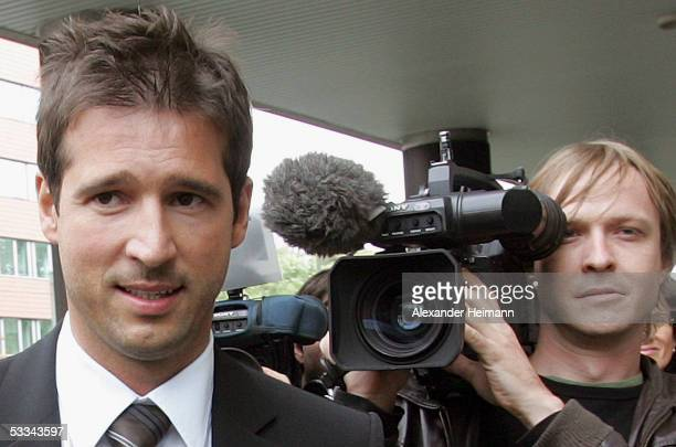 Former TV presenter Andreas Tuerk walks to court on August 9 2005 in Frankfurt Germany Tuerk is accused of raping a 26year old woman in August 2003