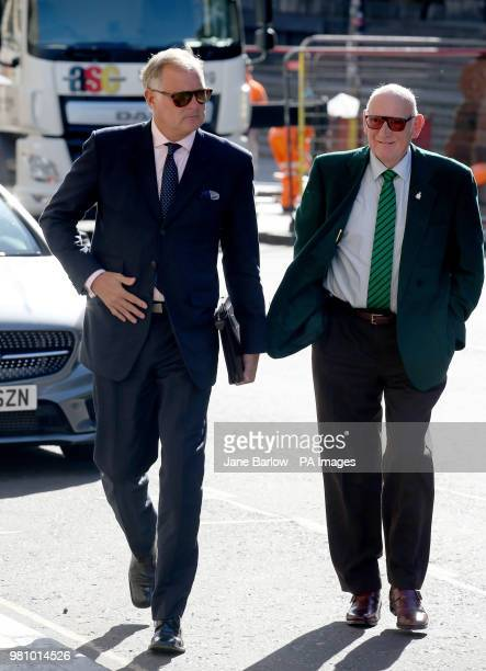 Former TV presenter John Leslie accompanied by his father Lesley Stott arrives at Edinburgh Sheriff Court where he is charged with sexually...