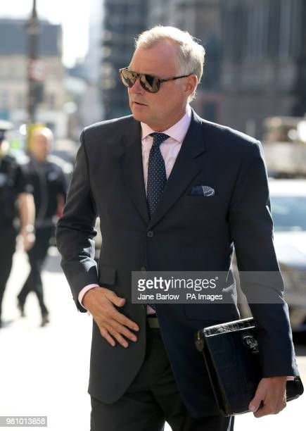 Former TV presenter John Leslie arrives at Edinburgh Sheriff Court where he is charged with sexually assaulting a woman by putting his hand down her...