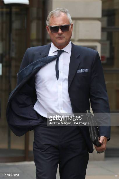 Former TV presenter John Leslie leaves Edinburgh Sheriff Court he accused of putting his hand down a woman's trousers as they danced at her hen night