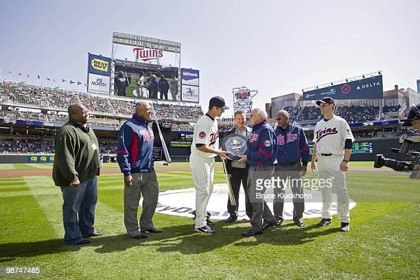 Former Twin Harmon Killebrew presents Joe Mauer of the Minnesota Twins with the 2009 AL MVP Award with La Velle Neal III Tony Oliva Chuck Schupp of...