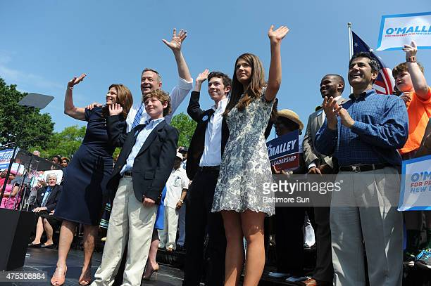 Former two-term Maryland governor Martin O'Malley, his wife, Katie, and children wave to the crowd after he announces his decision to seek the...
