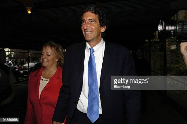 Former Tyco International CFO Mark Swartz leaves State Supreme Court with his wife Karen right in New York March 26 2004 The judge presiding at the...