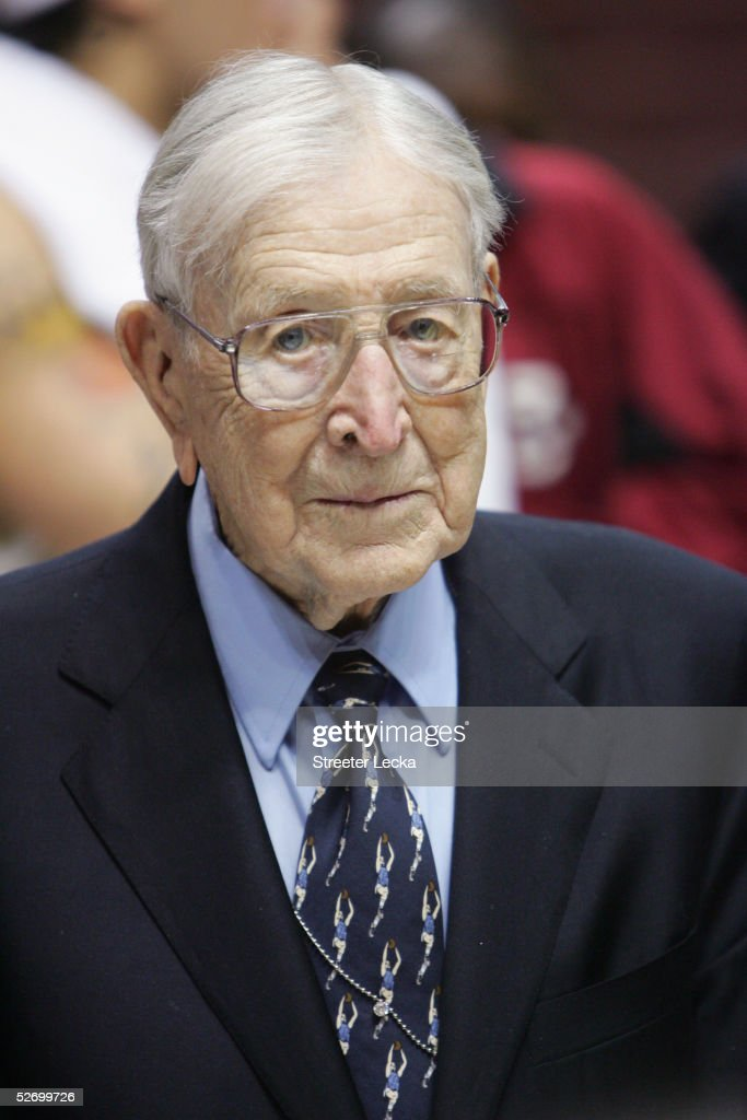 Former UCLA Bruins head coach John Wooden looks on after the game against the Boston College Eagles on December 5, 2004 at The Arrowhead Pond in Anaheim, California. Boston College won 74-64.