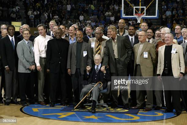 Former UCLA coach John Wooden is surrounded by former UCLA players during a ceremony to name the court at Pauley Pavilion Nell and John Wooden Court...