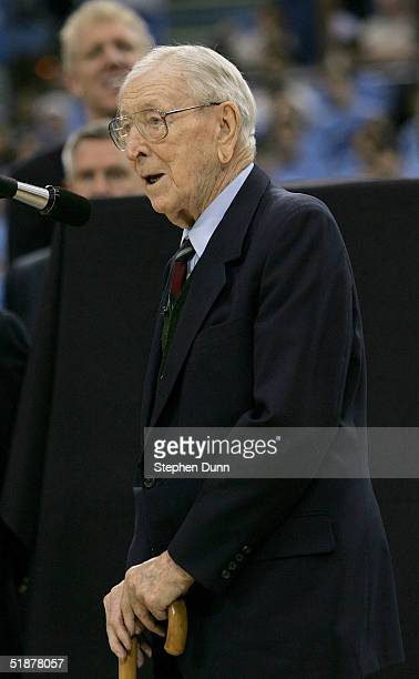 Former UCLA head coach John Wooden speaks to the crowd during the ceremony to retire the jersey of former player Gail Goodrich during halftime of the...