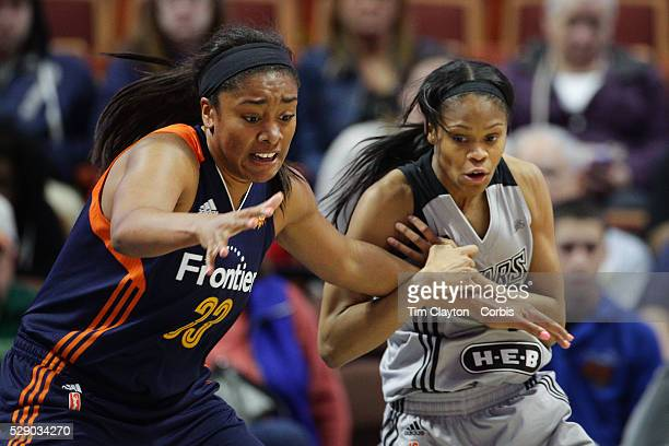 Former UConn Huskies Morgan Tuck of the Connecticut Sun and Moriah Jefferson of the San Antonio Stars challenge for the ball during the San Antonio...