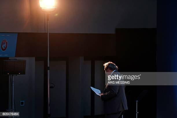 Former UEFA President Michel Platini leaves through a side door after delivering a speech during the opening of the 12th Extraordinary UEFA congress...