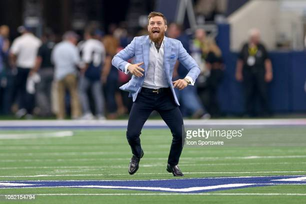 Former UFC Champion Conor McGregor plays catch on the field prior to the game between the Jacksonville Jaguars and Dallas Cowboys on October 14 2018...