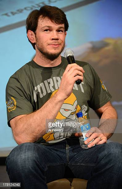 Former UFC light heavyweight champion Forrest Griffin interacts with fans during a UFC Fight Week Party at Lagasse's Stadium on July 5, 2013 in Las...