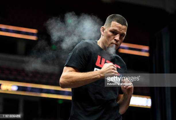 Former UFC lightweight title challenger Nate Diaz smokes during an open workout for fans and media at Honda Center on August 14, 2019 in Anaheim,...