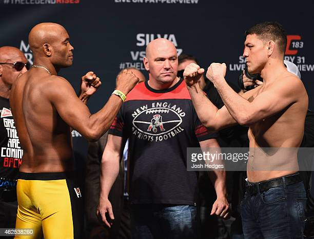Former UFC middleweight champion Anderson Silva and Nick Diaz face off during the UFC 183 weighin at the MGM Grand Garden Arena on January 30 2015 in...