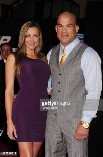 Former UFC Octagon girl Amber Miller and MMA fighter Tito Ortiz arrive at the Los Angeles premiere of 'Need For Speed' at TCL Chinese Theatre on...