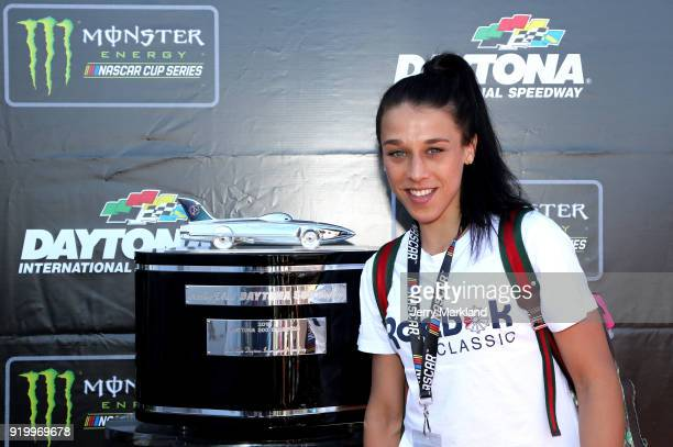 Former UFC Women's Strawweight Champion Joanna Jedrzejczyk poses with the Harley J Earl prior to the Monster Energy NASCAR Cup Series 60th Annual...