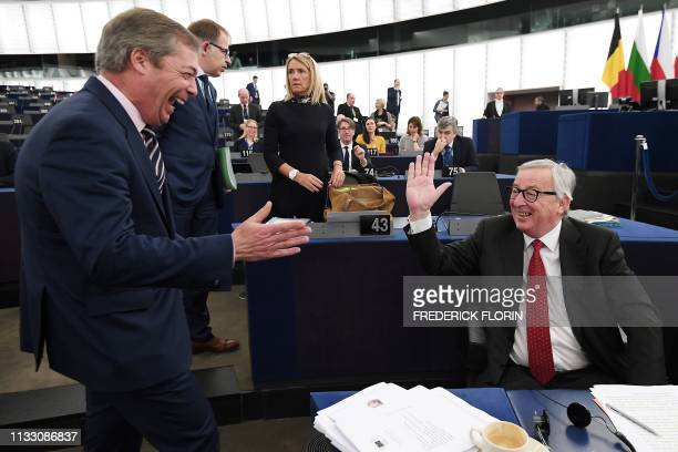 Former UK Independence Party leader Brexit campaigner and member of the European Parliament Nigel Farage speaks with European Commission President...