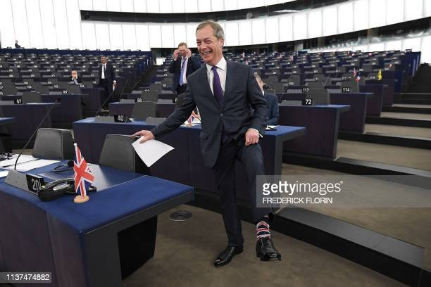 TOPSHOT Former UK Independence Party leader Brexit campaigner and member of the European Parliament Nigel Farage gestures ahead of a debate on UKs...