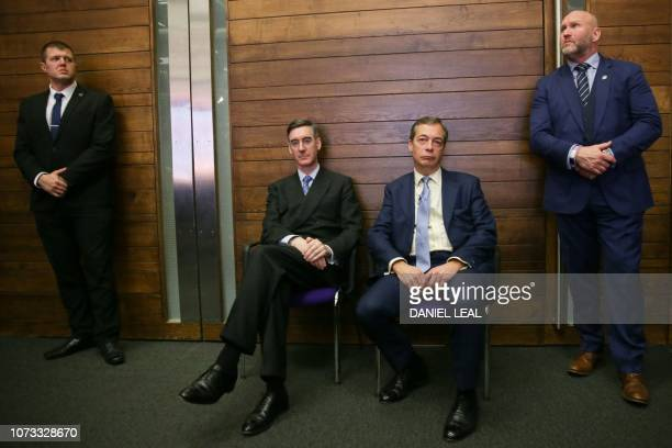 TOPSHOT Former UK Independence Party leader Nigel Farage sits next to Conservative Party MP and chairman of the European Research Group Jacob...