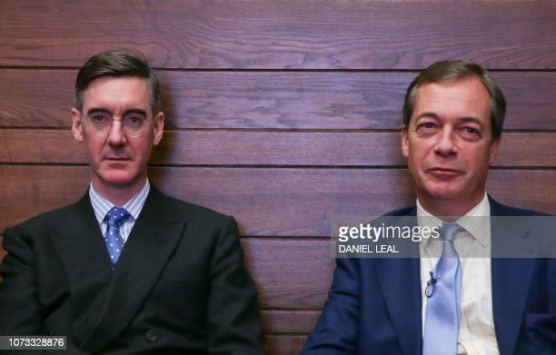 Former UK Independence Party leader Nigel Farage sits next to Conservative Party MP and chairman of the European Research Group Jacob ReesMogg in the...
