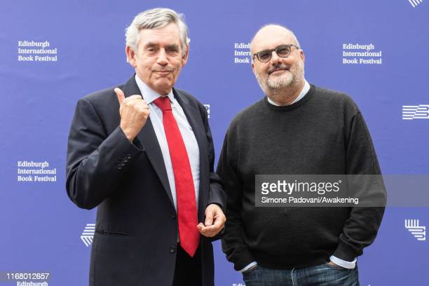 Former UK Prime Minister and leader of the Labour Party, Gordon Brown and Serbian-American economist Branko Milanovic attend a photo call during...