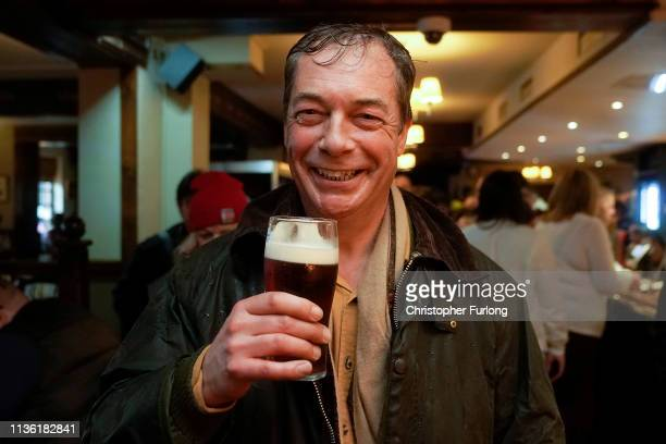 Former UKIP leader Nigel Farage arrives at the Merry Go Round Wacky Warehouse pub at the end of the first leg of 'March to Leave' walk from the Port...