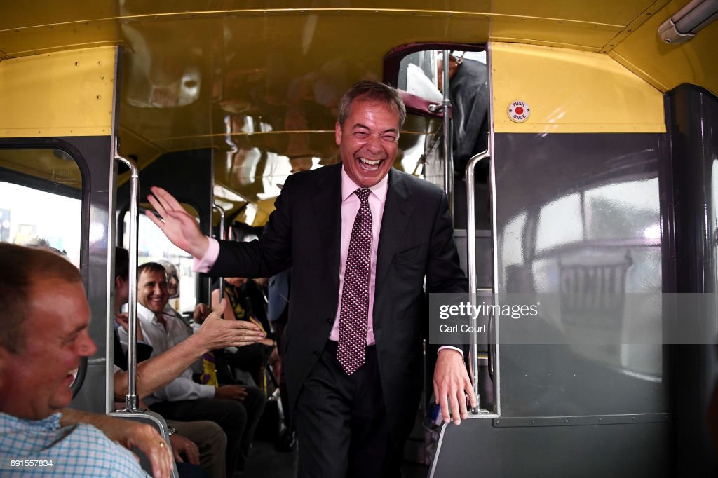 Former UKIP leader, Nigel Farage campaigns aboard the UKIP campaign bus on June 2, 2017 in Dagenham, England. All parties continue to campaign across the country ahead of the general election on June 8.