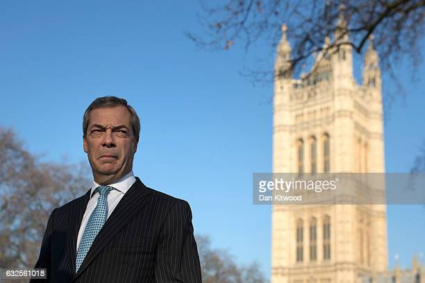 Former UKIP leader Nigel Farage conducts a television interview in Victoria Tower Gardens on January 24 2017 in London England Judges ruled by a...