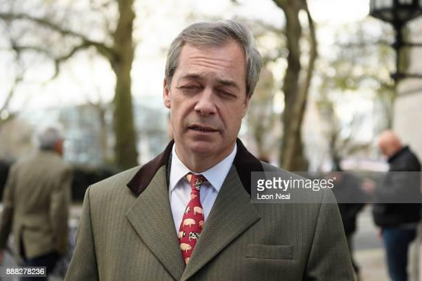 Former UKIP leader Nigel Farage leaves Millbank studios in Westminster on December 8 2017 in London England British Prime Minister Theresa May has...
