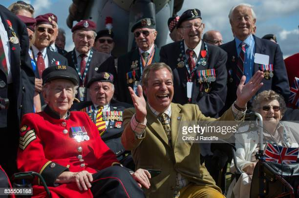 Former UKIP leader Nigel Farage poses for photographs with veterans and Chelsea Pensioners next to a Spitfire on display at the Biggin Hill Festival...