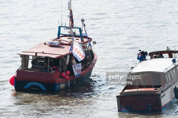 Former Ukip leader Nigel Farage poses for the media during Fishing for Leave protest on the river Thames in Westminster against the impact of Brexit...
