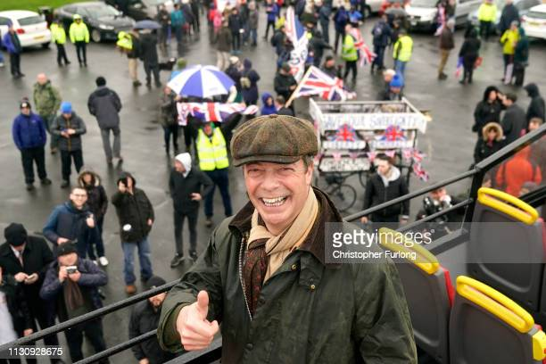 Former UKIP leader Nigel Farage poses on top of an open top proBrexit bus during the 'March to Leave' walk from the Port of Sunderland on March 16...
