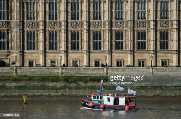 Former UKIP party leader Nigel Farage and Fishing for Leave supporters pass the Houses of Parliament before throwing fish overboard into the River...